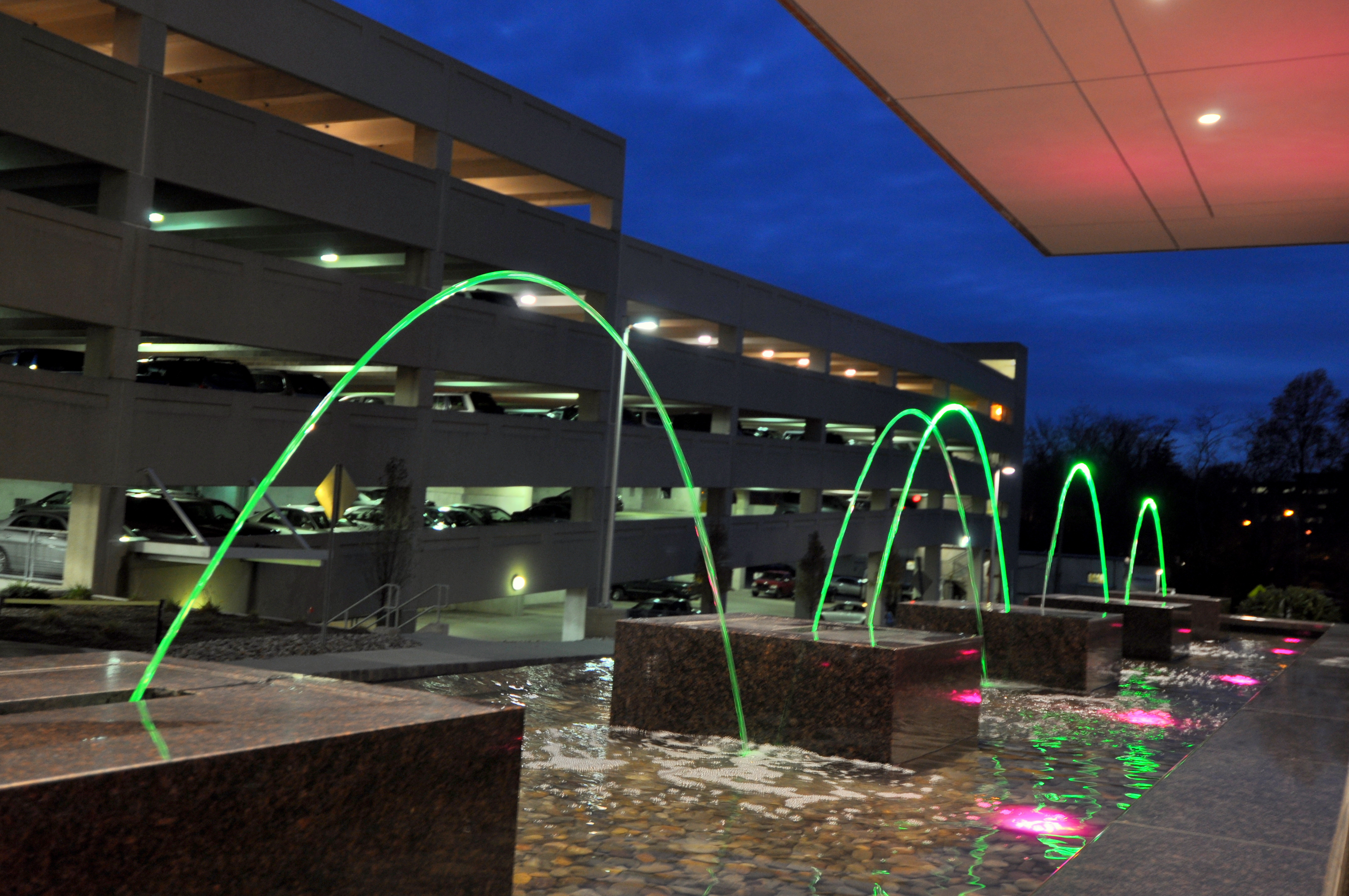 Interactive water feature with jumping jets