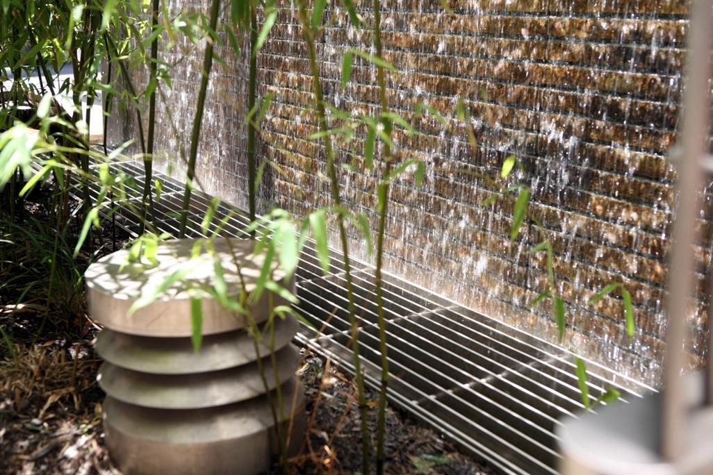 Detail of natural stone water wall at condominium entrance