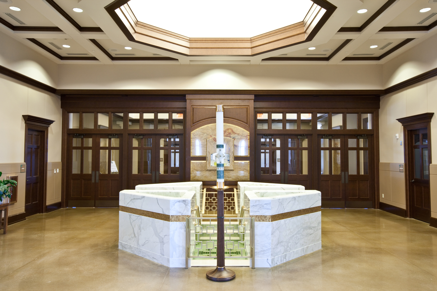 Octagonal Baptismal Font with Four Triangular Upper Bowls with Spillways and Descending and Ascending Steps into a Cruciform Lower Pool, St. Eugene, Oklahoma City, OK.